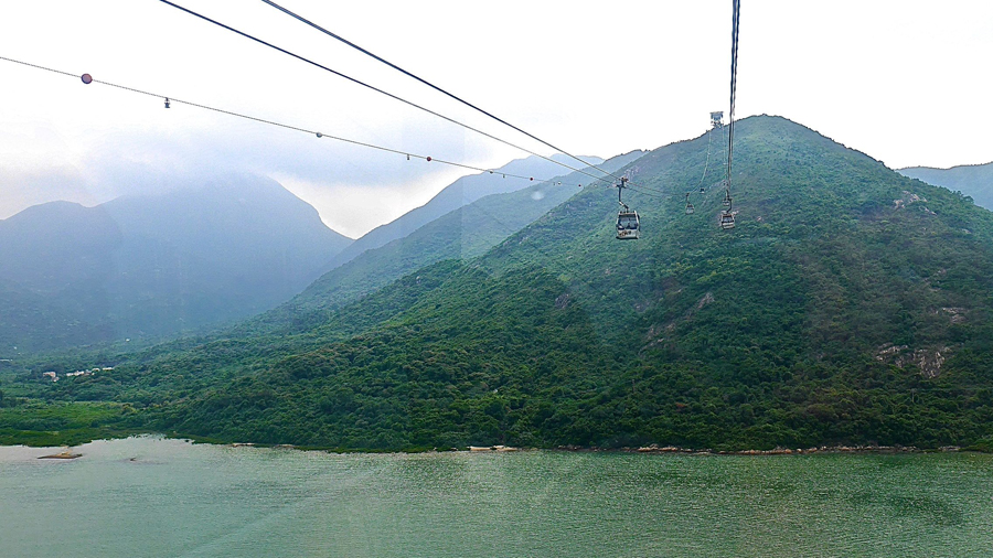 Ascending into the mist on a voyage to The Big Buddha via cable car