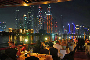 Dhow cruise with dinner and evening views of Old Dubai's historic landmarks together with new structures of the Creek