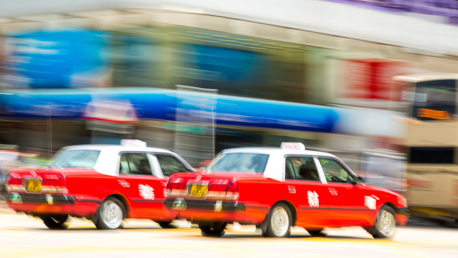 Vintage red cabs from the airport