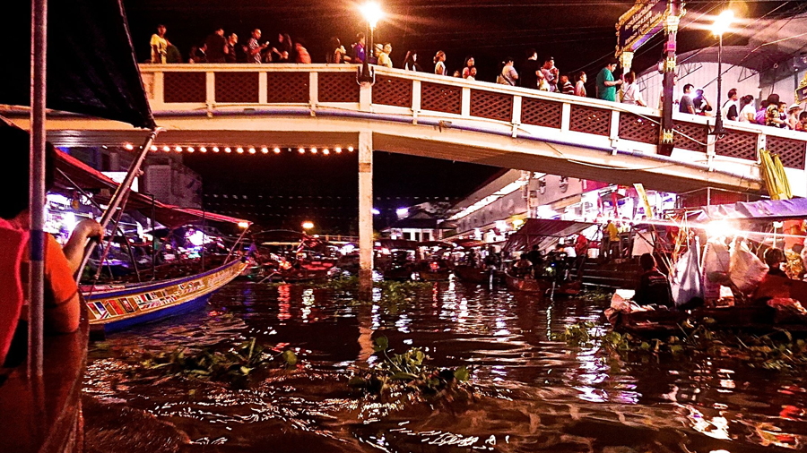 At night the floating markets light up as locals flock there for their evening meals