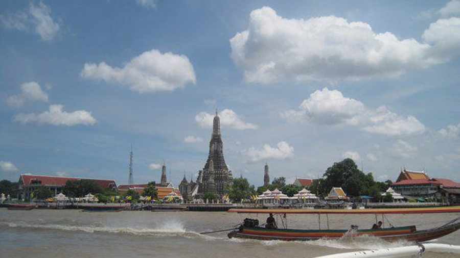 Taking a boat to the impressive Wat Arun