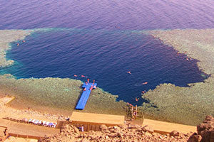Blue Hole is a diving location on east Sinai, a few kilometres north of Dahab, on the coast of the Red Sea. The Blue Hole is a submarine sinkhole, around 130 m deep.