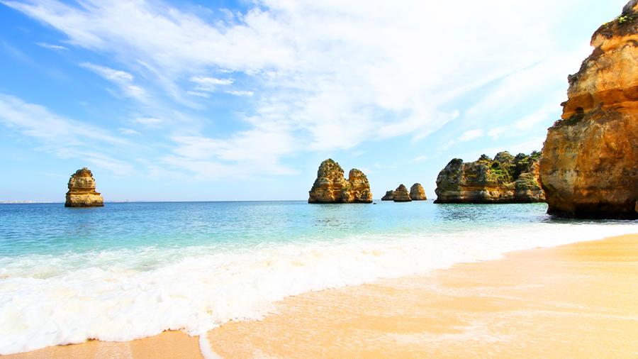 The path leads down onto scenic Praia da Oura beach